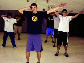 Boys dance team practices for performance