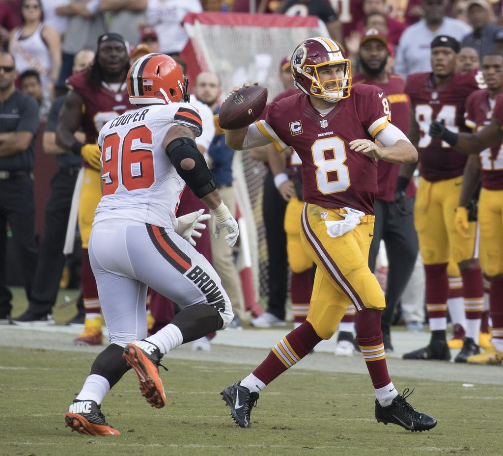 Washington Redskins quarterback Kirk Cousins rolls out for to pass during a regular season game against the Cleveland Browns in October of 2016. Cousins signed a franchise tag for the second straight season.