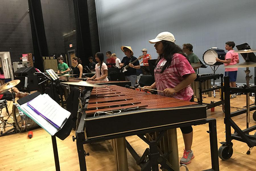 "Muñoz enjoys this year's marching band theme ""Time Warp"""