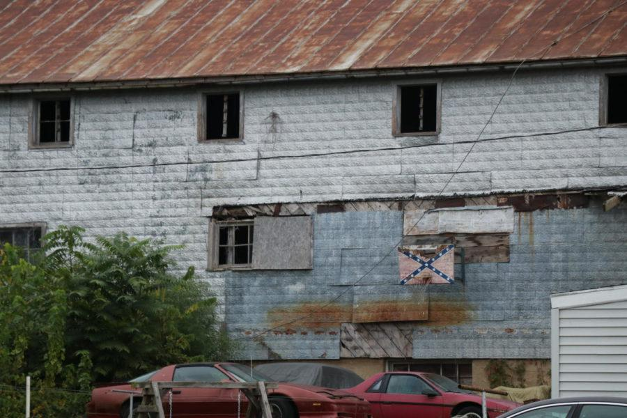 A Confederate Battle flag hangs on the side of a building in Broadway, VA.