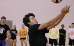 Boys compete in DECA powderpuff volleyball
