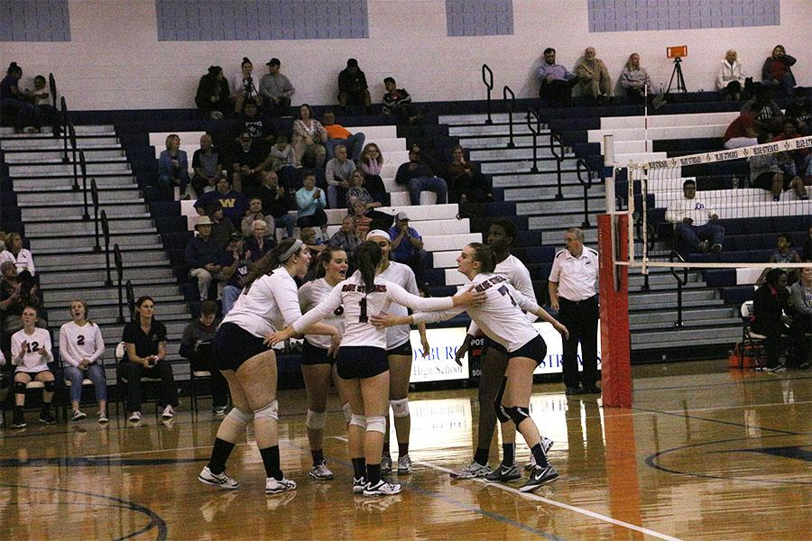 The Streaks celebrate after scoring a point in the first set.