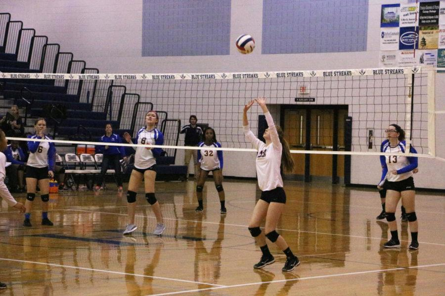 Sophomore+Whitney+Purcell+sets+the+ball+to+teammate.+