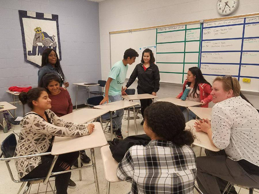 Several students in ninth grade academy meet to set plans and goals for what they want to do to help Anicira, a non-profit animal shelter.