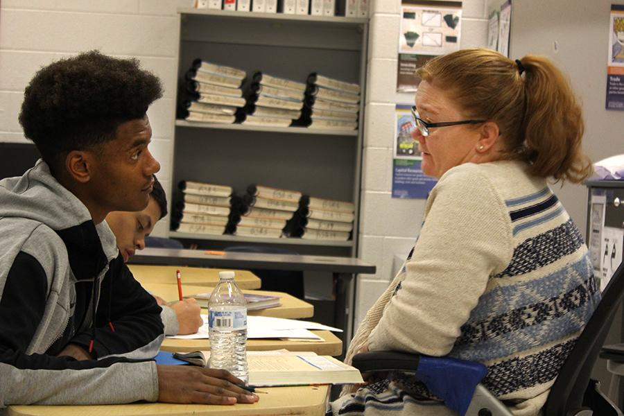 """Junior D'Andre Moats works with teacher Melissa Thurman during night school. """"[Night school] is more interaction,"""" Moats said. """"If you would like a teacher in front of you, helping you a lot more, I would recommend night school."""""""