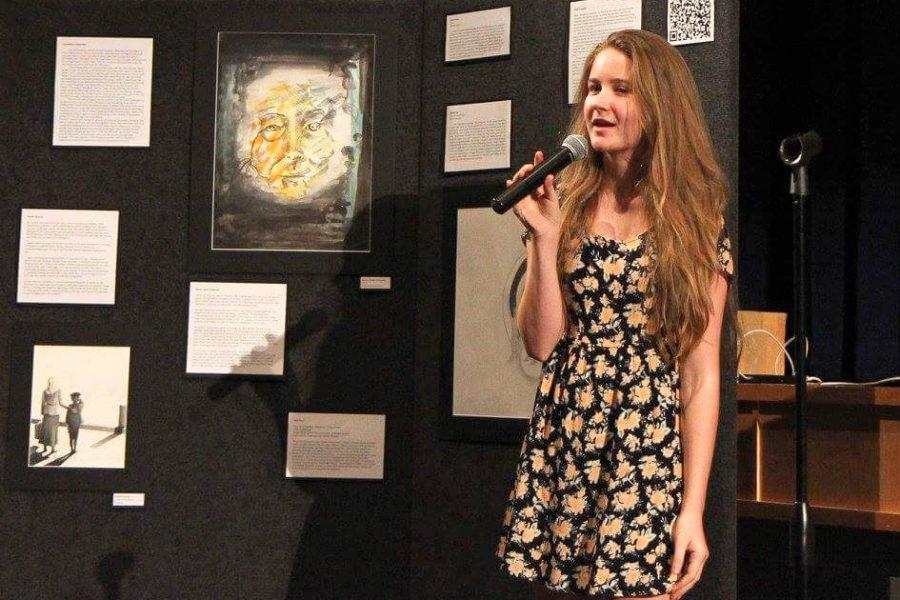 Snell-Feikema talks about her art at a senior fine arts showcase.