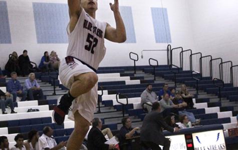 Boys varsity basketball moves on to regional semifinals