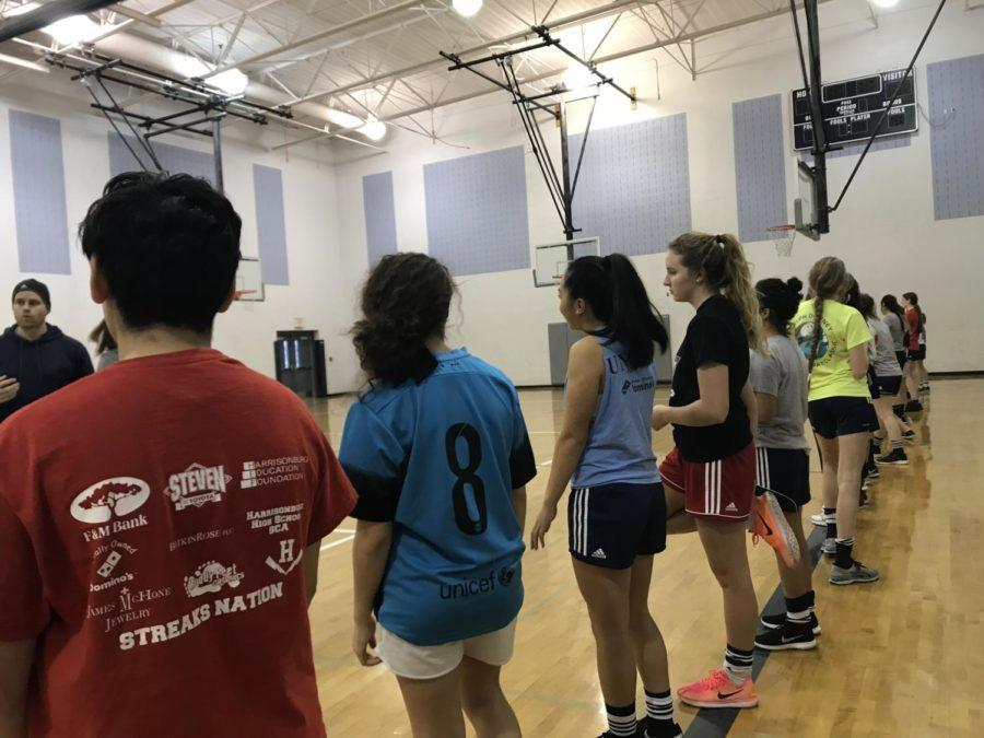 Freshman+girls+prepare+for+tryouts+with+team+warm+ups.