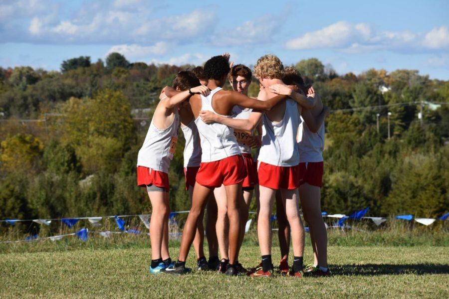 The cross country team huddles up before their district meet race