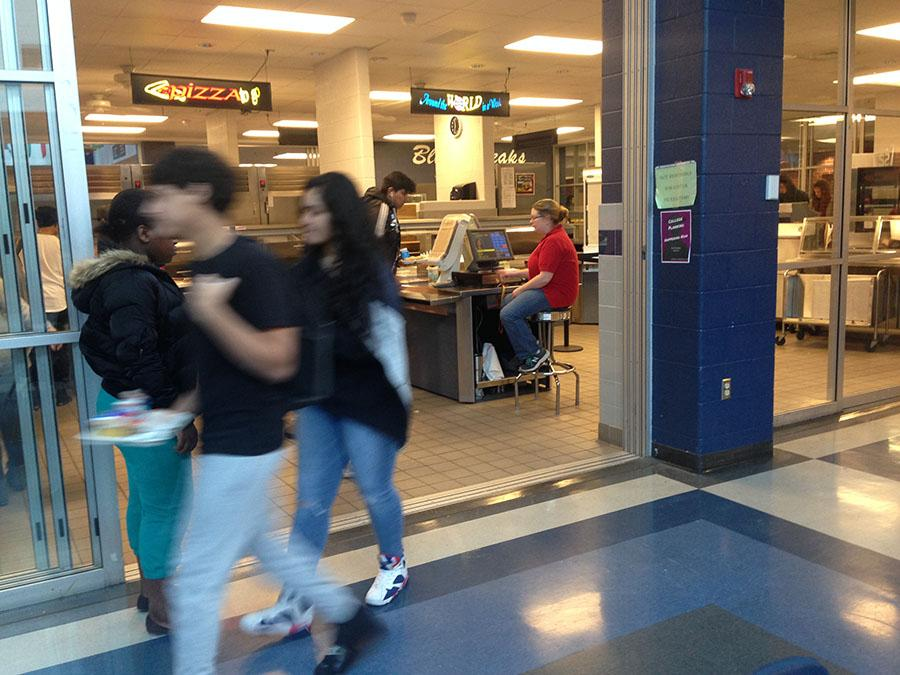 Students walk in and out of one of the lunch lines.