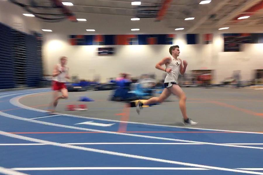 Sophomore Tucker McGrath competes in the 3200m, closely followed by senior Jacob Blagg.