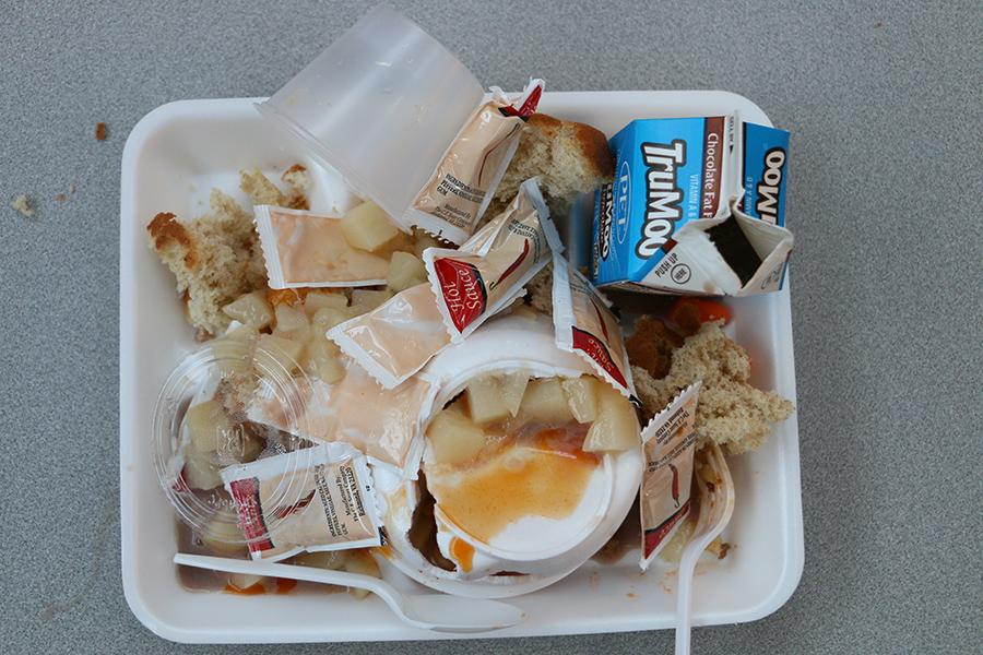 A student's lunch tray sits on a table after third lunch.