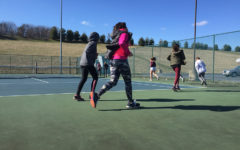 Girls tennis team acquires players new to sports