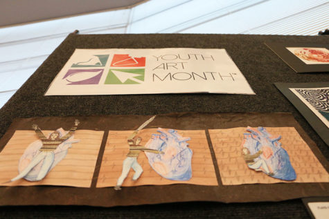 Art department features teacher artwork in honor of Youth Art Month