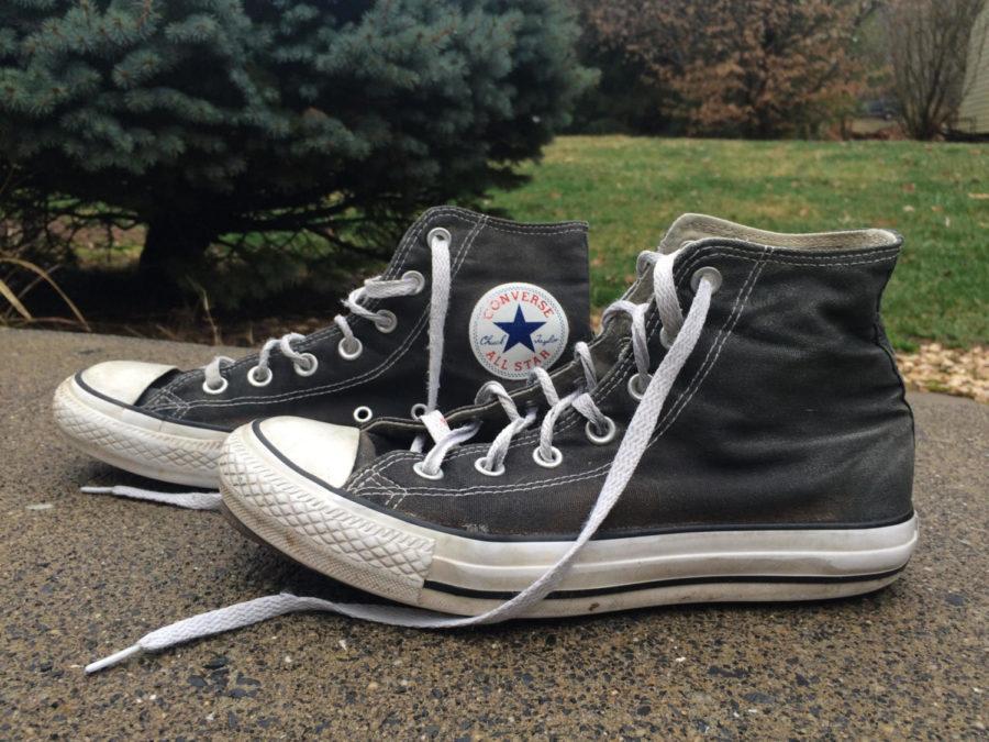 A pair of black Converse Chuck Taylors.