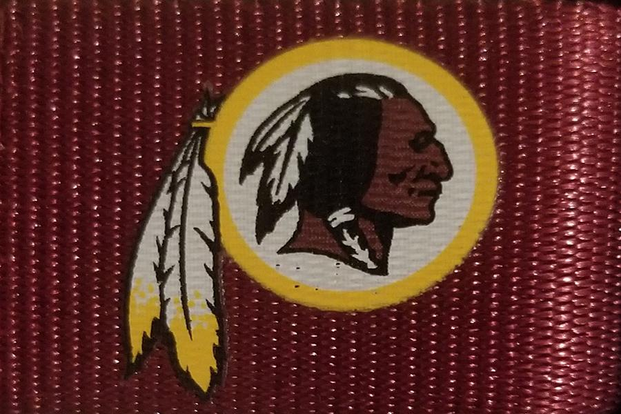 The Redskins logo appears on a shirt.