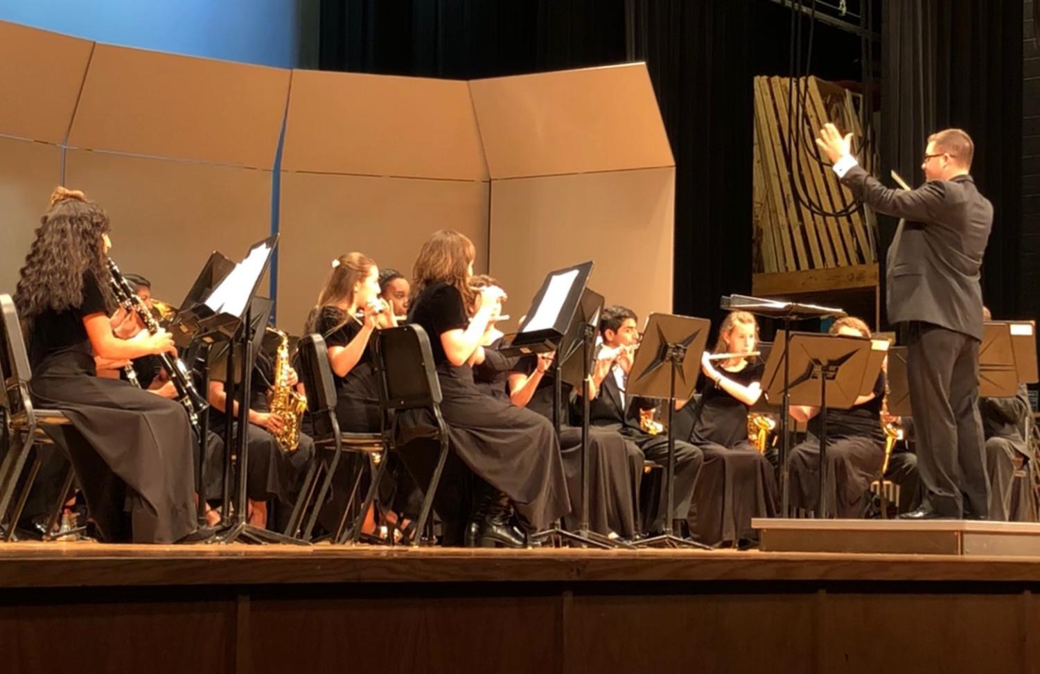 Band director Daniel Upton conducts the concert band during their performance of Gabriel Musella and Rick Rodriguez's